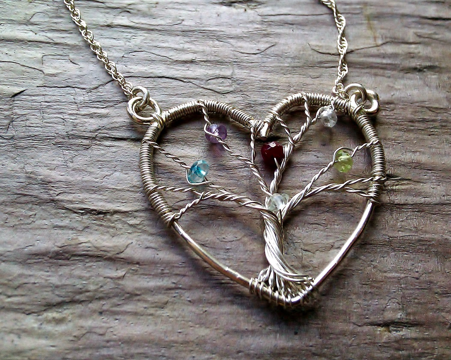 https://www.etsy.com/listing/72678116/heart-family-tree-necklace-personalized