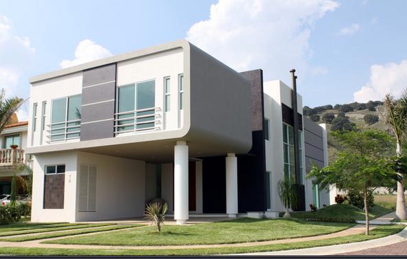 Viviendas modernas fachada de casa moderna de tres pisos for Viviendas modernas