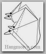 Bước 14: Gấp chéo bốn cạnh giấy vào trong giữa hai lớp giấy.