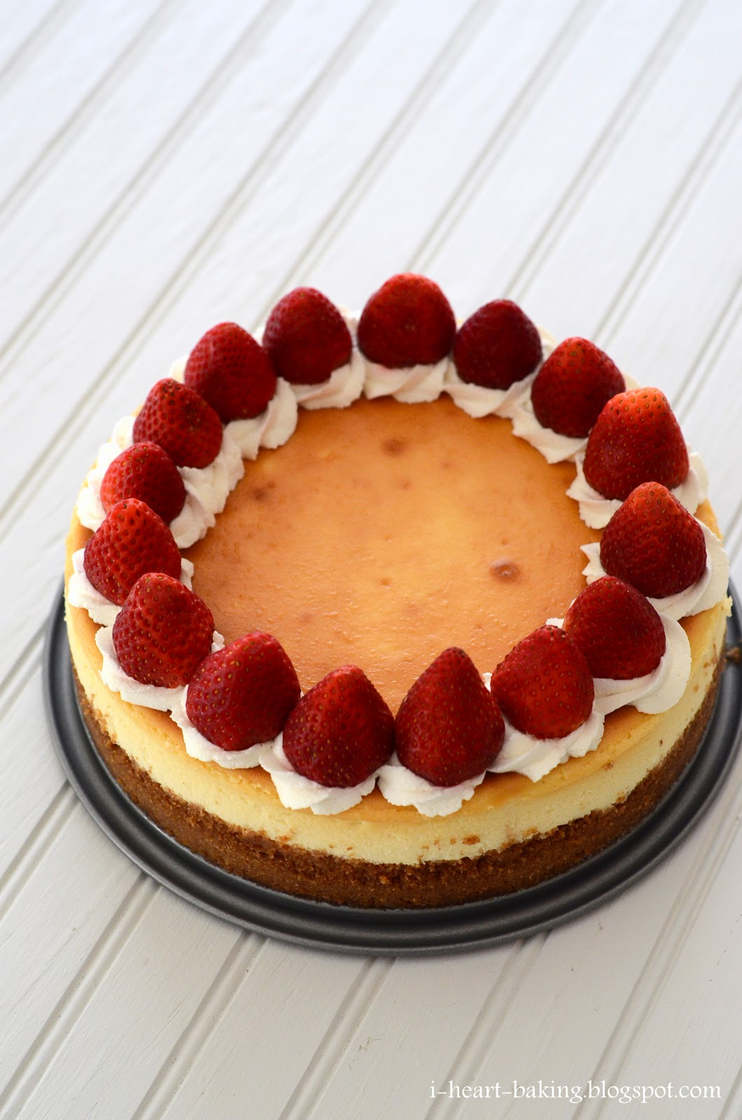 i heart baking classic cheesecake decorated with whipped cream and