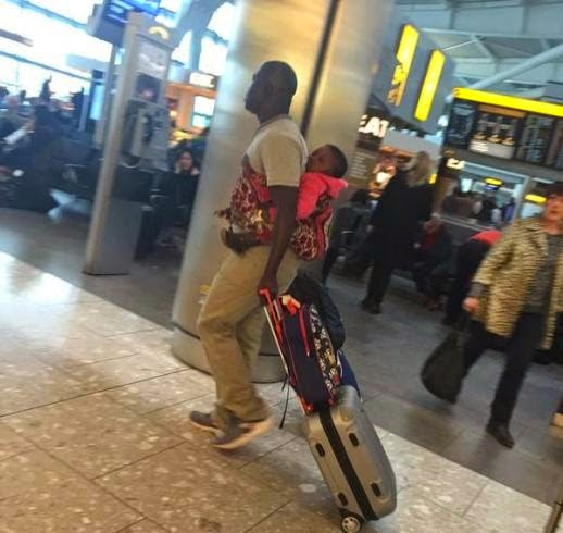 man wrapper baby london aiport