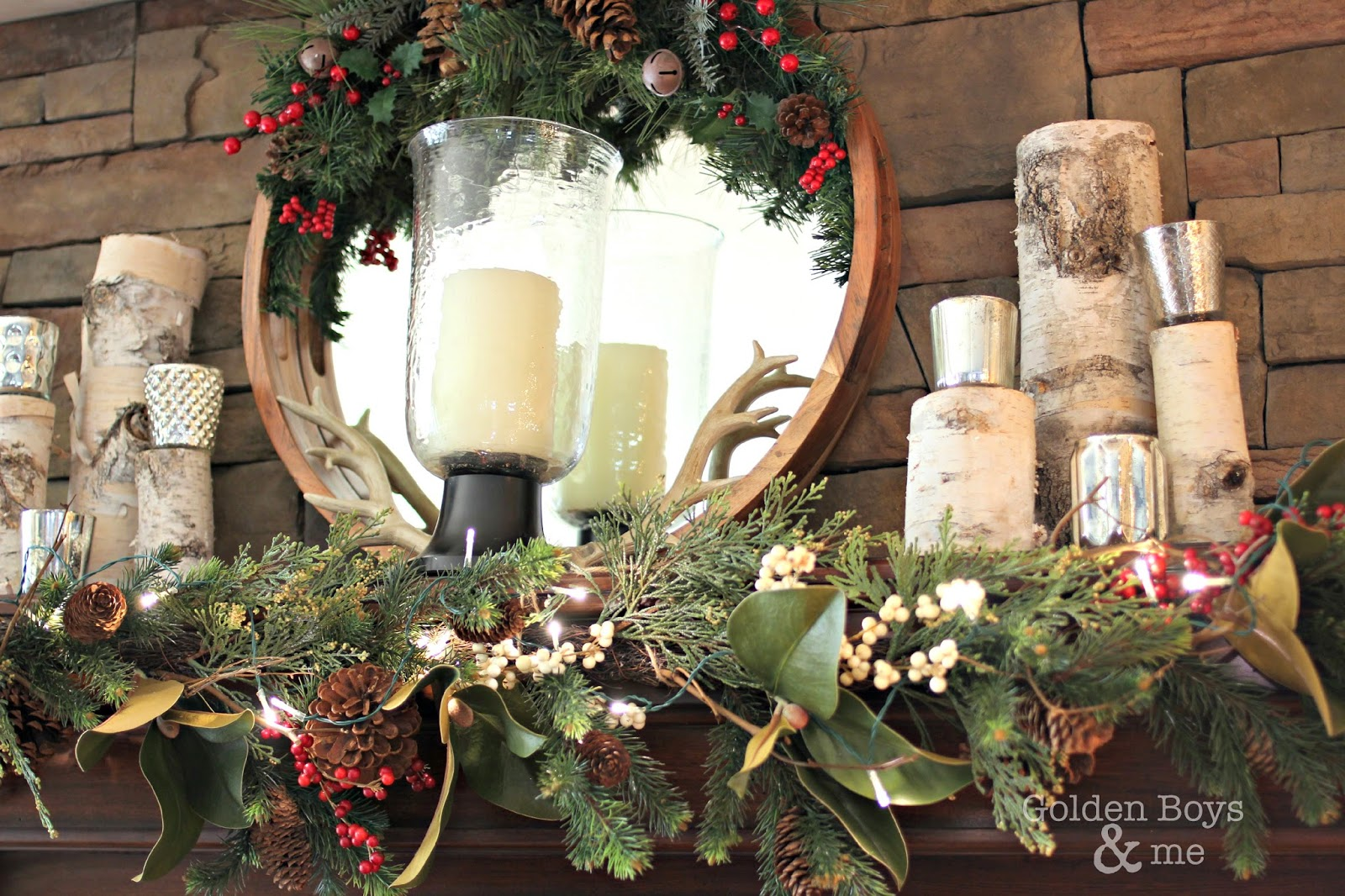Pottery Barn magnolia and berry garland with mercury glass votives and mirror in Christmas family room-www.goldenboysandme.com