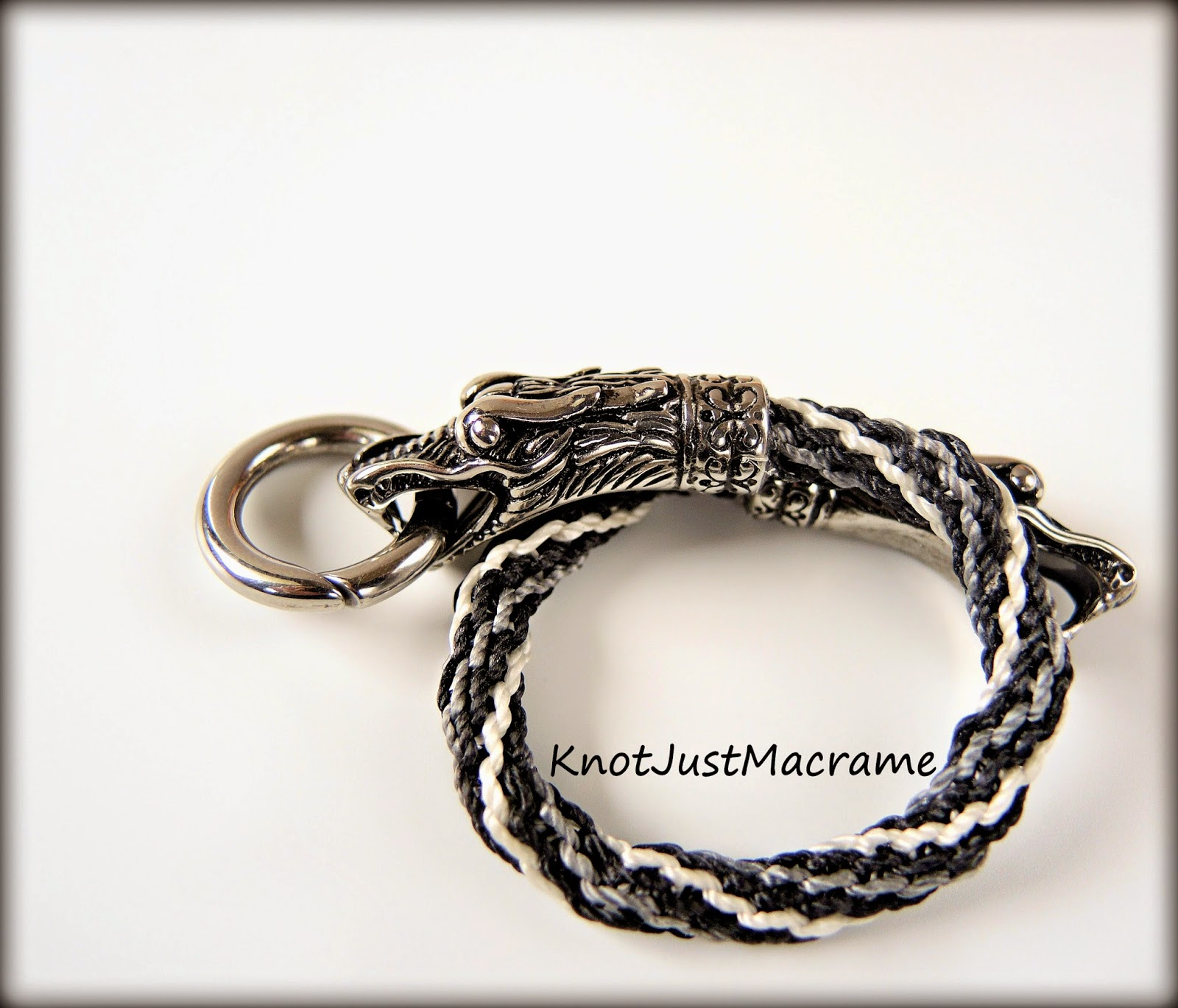 Micro macrame bracelet with dragon heads closure by Sherri Stokey of Knot Just Macrame.