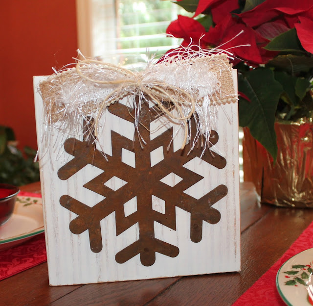Snowflake Christmas ornament on historic block wood
