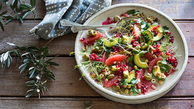 Smashed green olive and ruby grapefruit salad