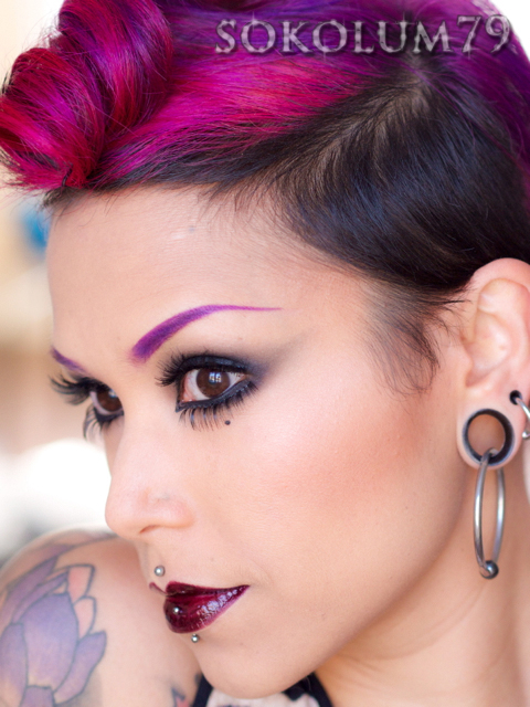 Dark smoky eye and victory roll with side cut
