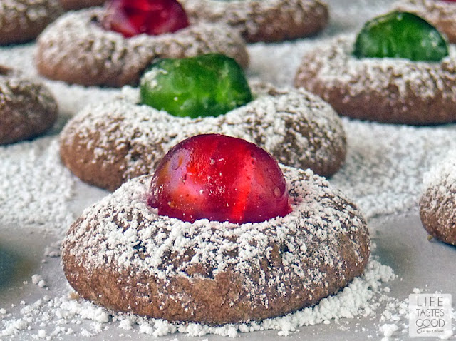 Chocolate Cherry Cookies | by Life Tastes Good are a wonderful addition to your Christmas cookie tray. A delicately rich chocolate cookie studded with a sweet candied cherry is as delicious as it is beautiful. These festive cookies are easy to make too!