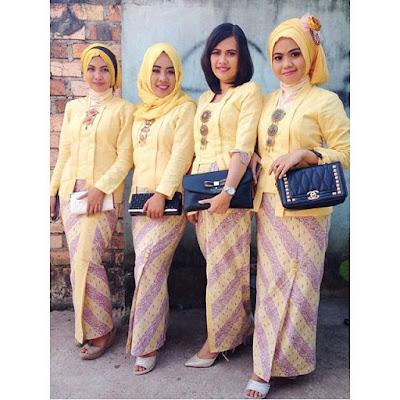 kebaya kuning polos hijab dengan rok batik motif parang