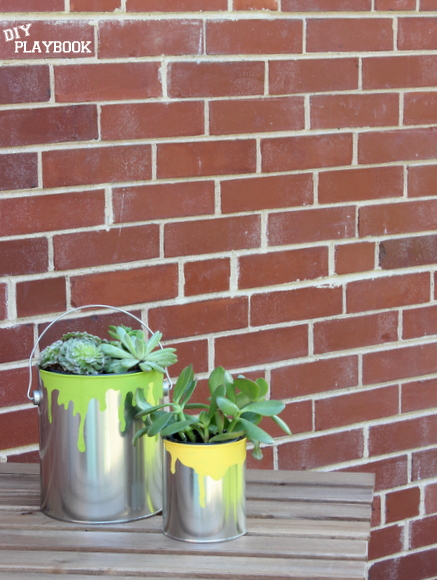 This easy paint can planter is a perfect father's day gift.