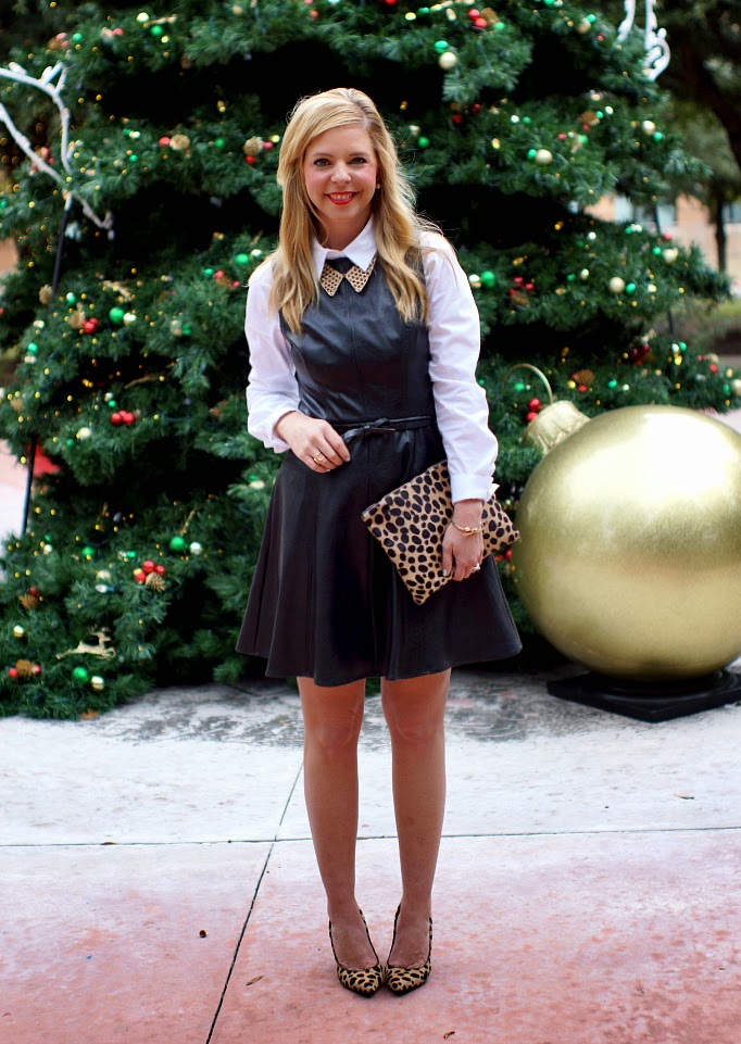 Black leather fit and flare dress with leopard accessories
