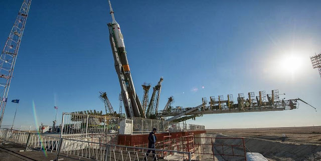 The Soyuz TMA-10M spacecraft is erected into position after being rolled out to the launch pad by train on Sept. 23, 2013, at the Baikonur Cosmodrome in Kazakhstan. Launch of the Soyuz rocket is scheduled for Sept. 26, Kazakh time, and will send Expedition 37 Soyuz Commander Oleg Kotov, NASA Flight Engineer Michael Hopkins and Russian Flight Engineer Sergey Ryazanskiy on a five and a half month mission aboard the International Space Station. Photo credit: NASA/Carla Cioffi