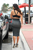 Kim Kardashian wearing a tight skirt