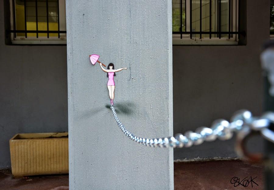 10-La-Funambule-The-Tightrope-Walker-OakOak-Street-Art-Drawing-in-the-City-www-designstack-co