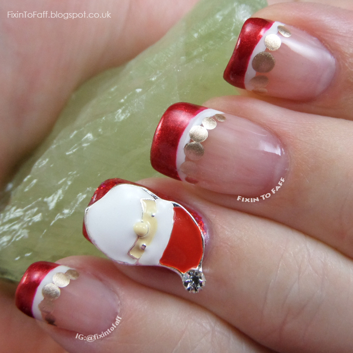 Santa Claus French Tip nail art with nail charm.