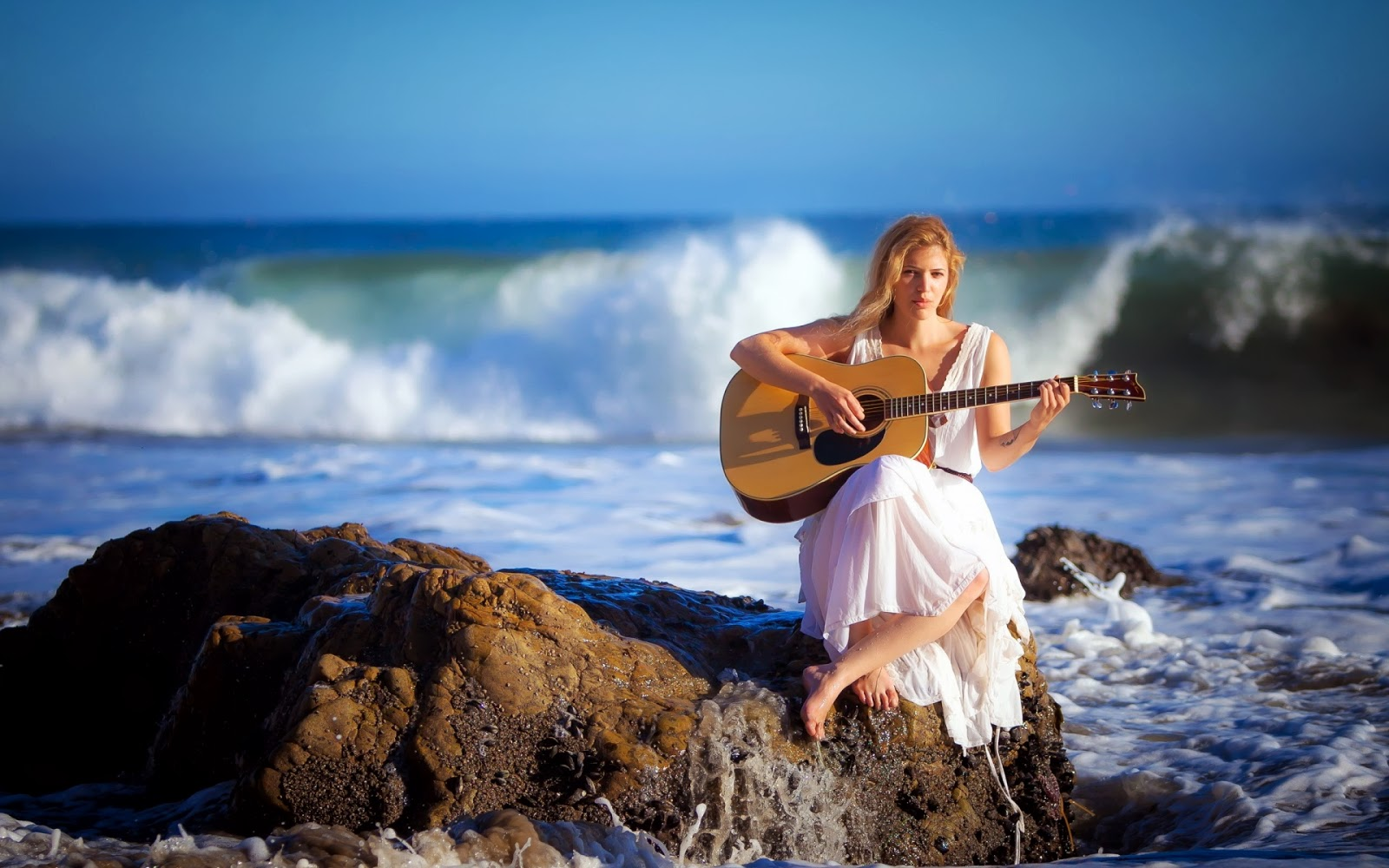 Woman Playing Guitar Coast | Mystery Wallpaper