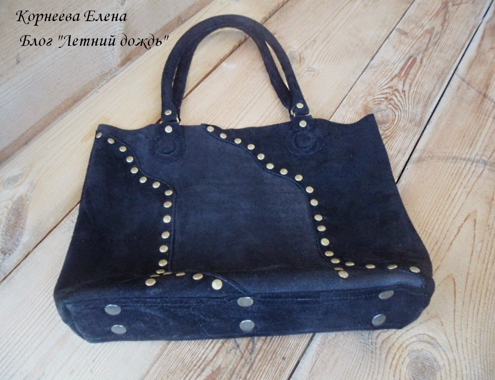 кожаная сумка с заклепками
