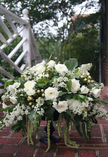 White roses, amaranthus, jasmine in urn, Isha Foss Events