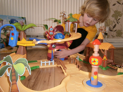 4 year old playing with jungle junction large playset from flair