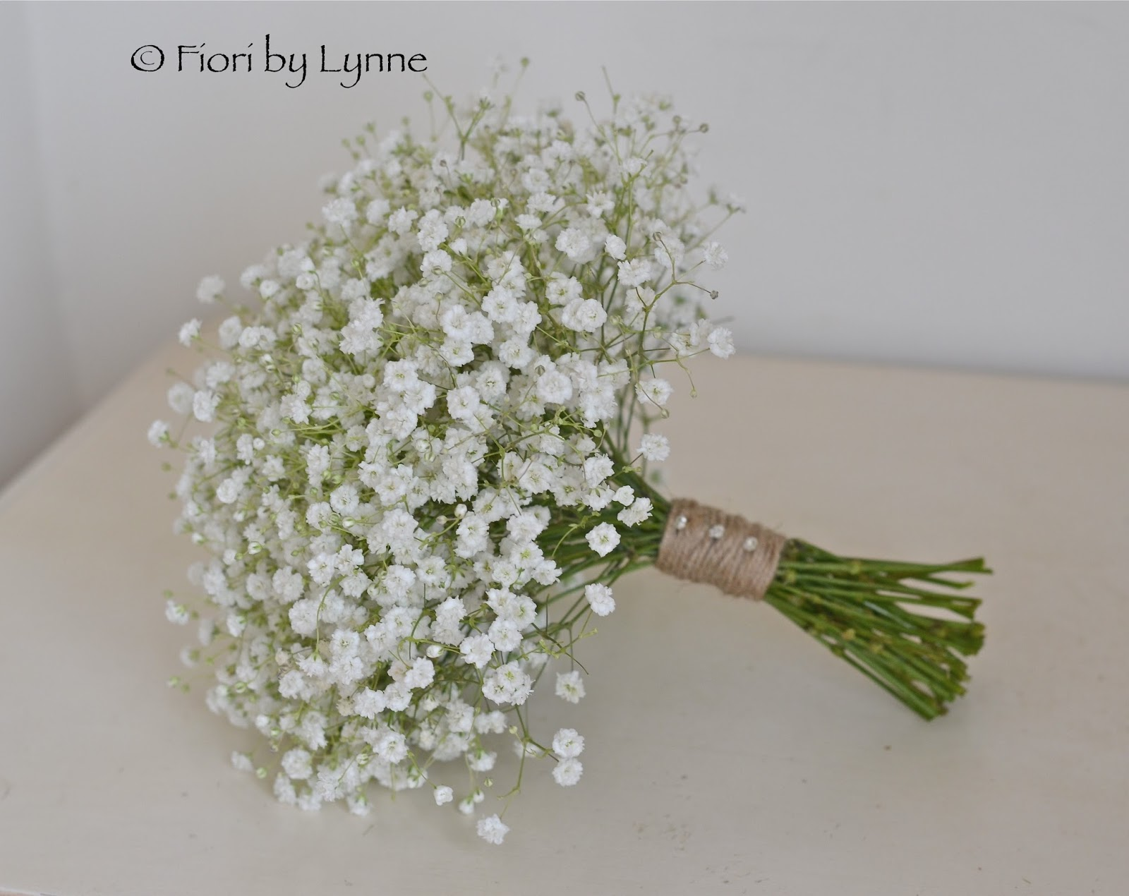 Bridesmaids Bouquets Of Massed Gypsophila Finished With Brown String And Diamante Pin