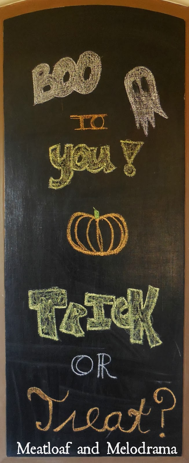 pantry door with chalkboard paint and chalkboard halloween sign
