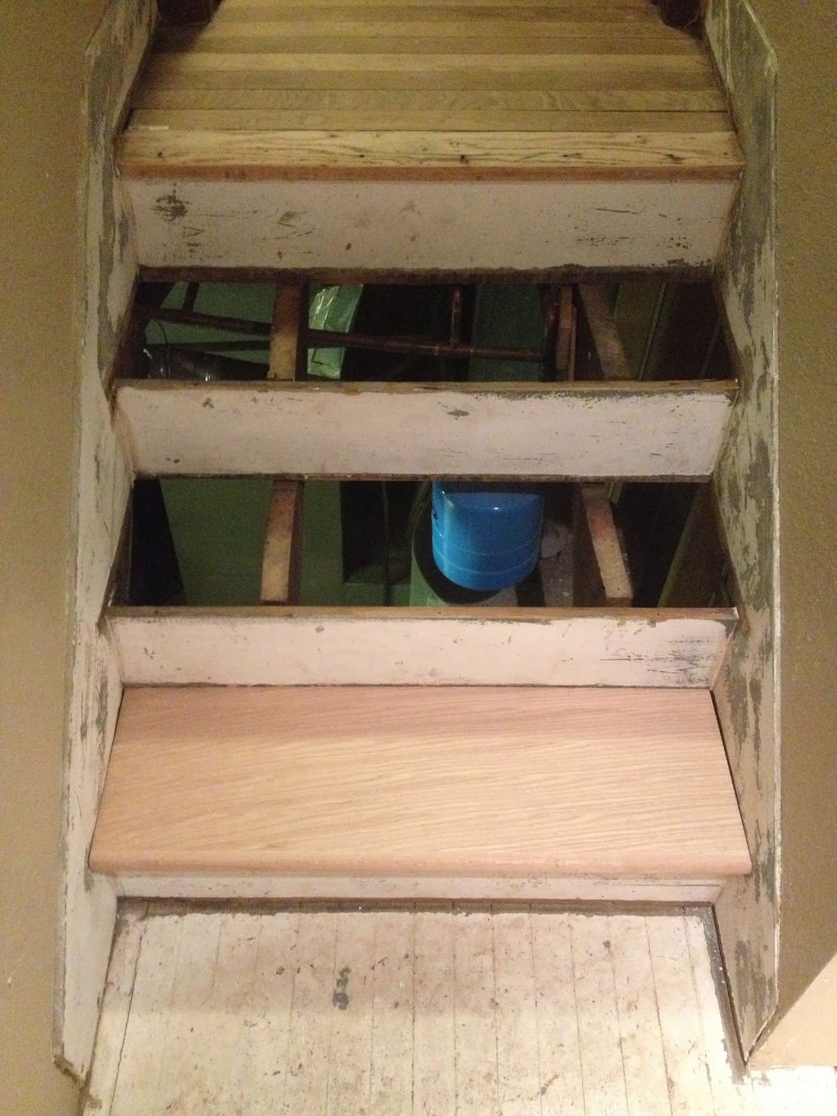 Old Stair Treads Are Removed (giving A Lovely View Of The Water Heater) And  Chris Sized New Treads Prior To Installing.