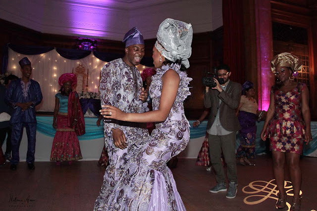 bride and groom dancing and wearing traditional african outfits at Porchester Hall wedding