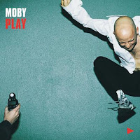 album cover to Moby, Play, Moby jumping in the air