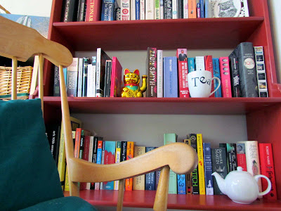 bookshelf, cup of tea, lucky cat, rocking chair, billy bookcase, mug, frame, red, paperback reading