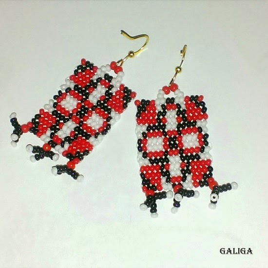 black white red earrings in ethnic style