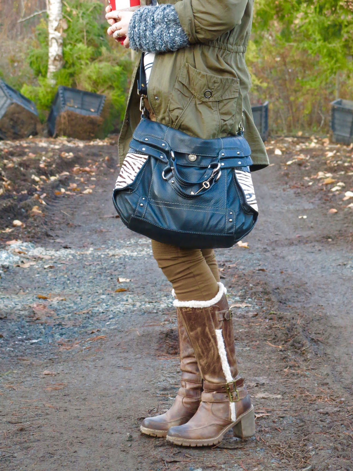 khaki skinnies, layered jackets, lug-soled boots, and Fossil bag