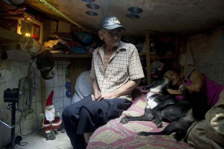 Miguel Restrepo, his wife and their dog Blackie are two happy underground squatters