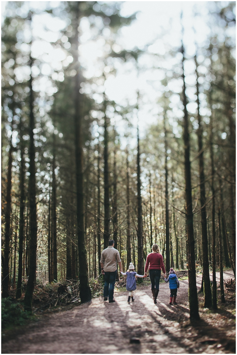 Family walking through the forest together