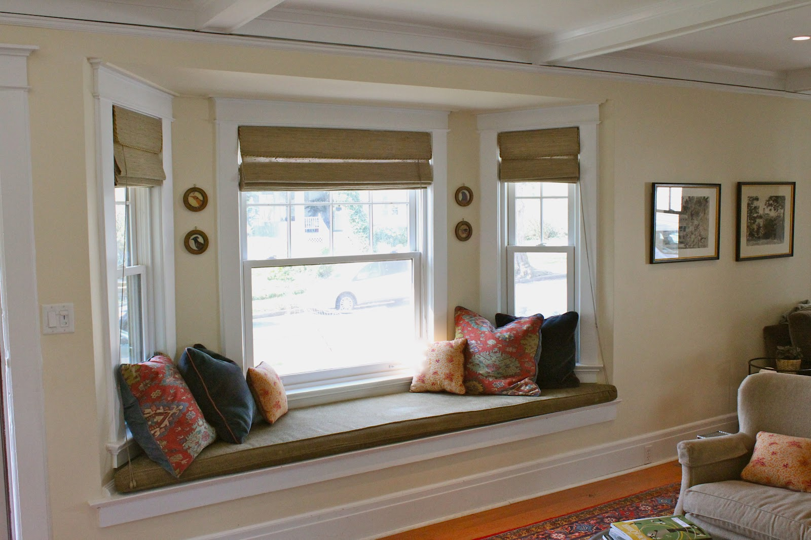 a long window seat flanked with big pillows provides the perfect place to  lounge while reading