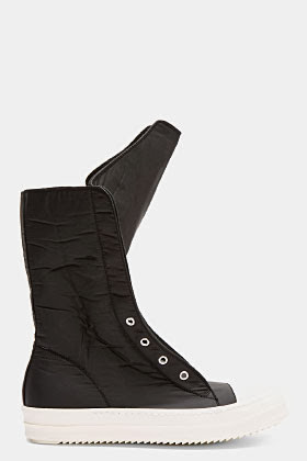 http://www.ssense.com/men/product/rick_owens_drkshdw/black_coated_cotton_plush_very_high-top_sneakers/81188