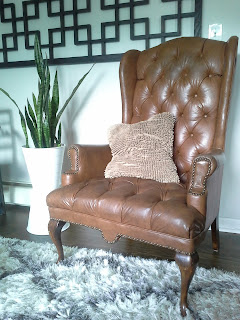 Tufted leather wing back chair