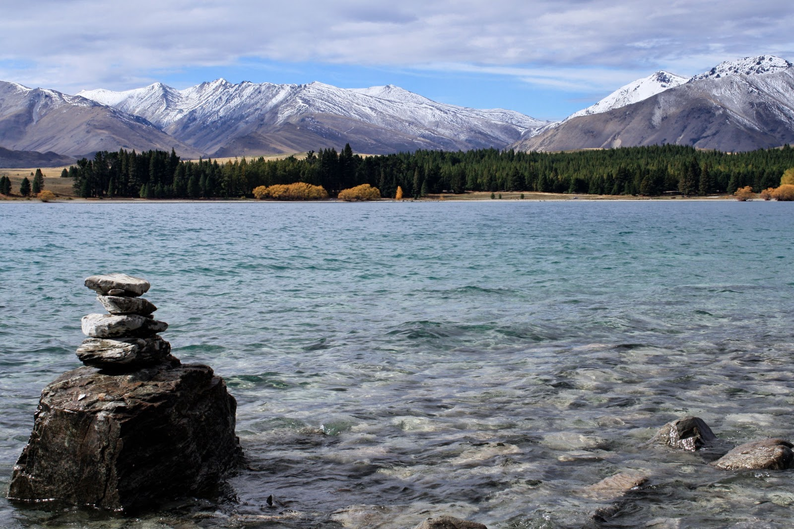 A pile of stacked stones in Lake Tekapo, in the South Island of New Zealand.