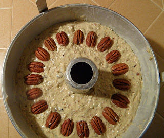 Overhead view of batter decorated with pecans