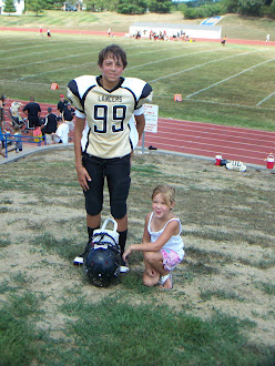 Christian and Bella in her football pose.