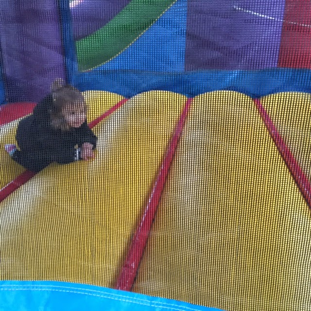 Toddler in bounce house | Bubbles and Gold