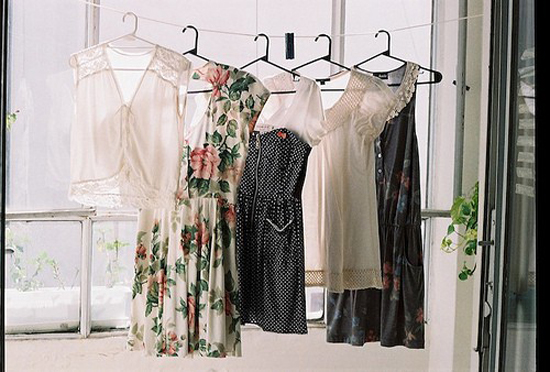 dresses hanging in window