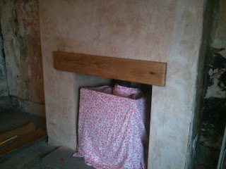 Fitting a new fake lintel to the fireplace