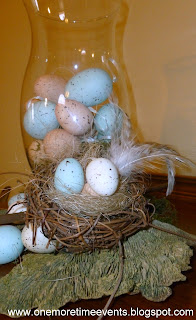 Glass cylinder filled with eggs on grapevine wreath at One More Time Events.com