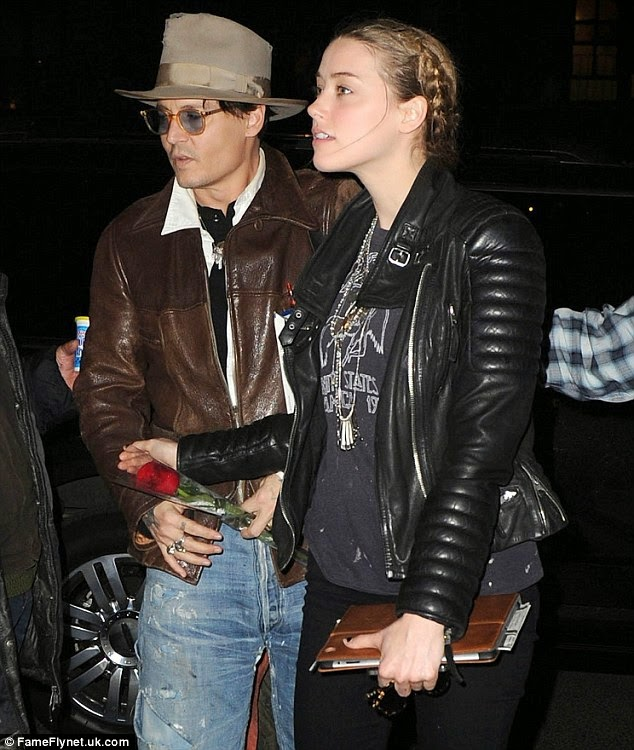 Johnny Depp spoils Amber Heard with cake and a huge bunch of roses