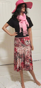 Ladies Animal Print Full Circle skirt in shades of red, black, and pink.