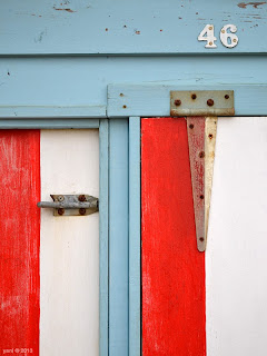 beach hut forty six red white and blue
