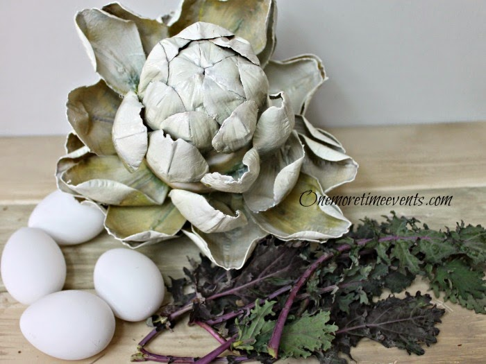 Faux artichoke,plastic eggs and fresh lettuce at One more Time Events.com