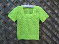 """Petal Pullover"" crocheted in green."