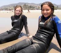 2 Aloha Beach Camp girls looking for some good waves at Zuma Beach in Malibu.