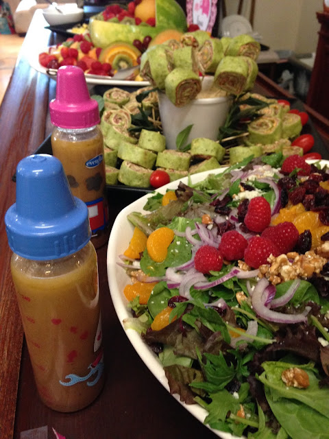 raspberry vinaigrette served in a baby bottle