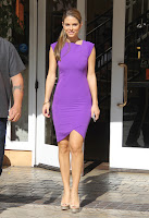 Maria Menounos wearing a tight purple dress